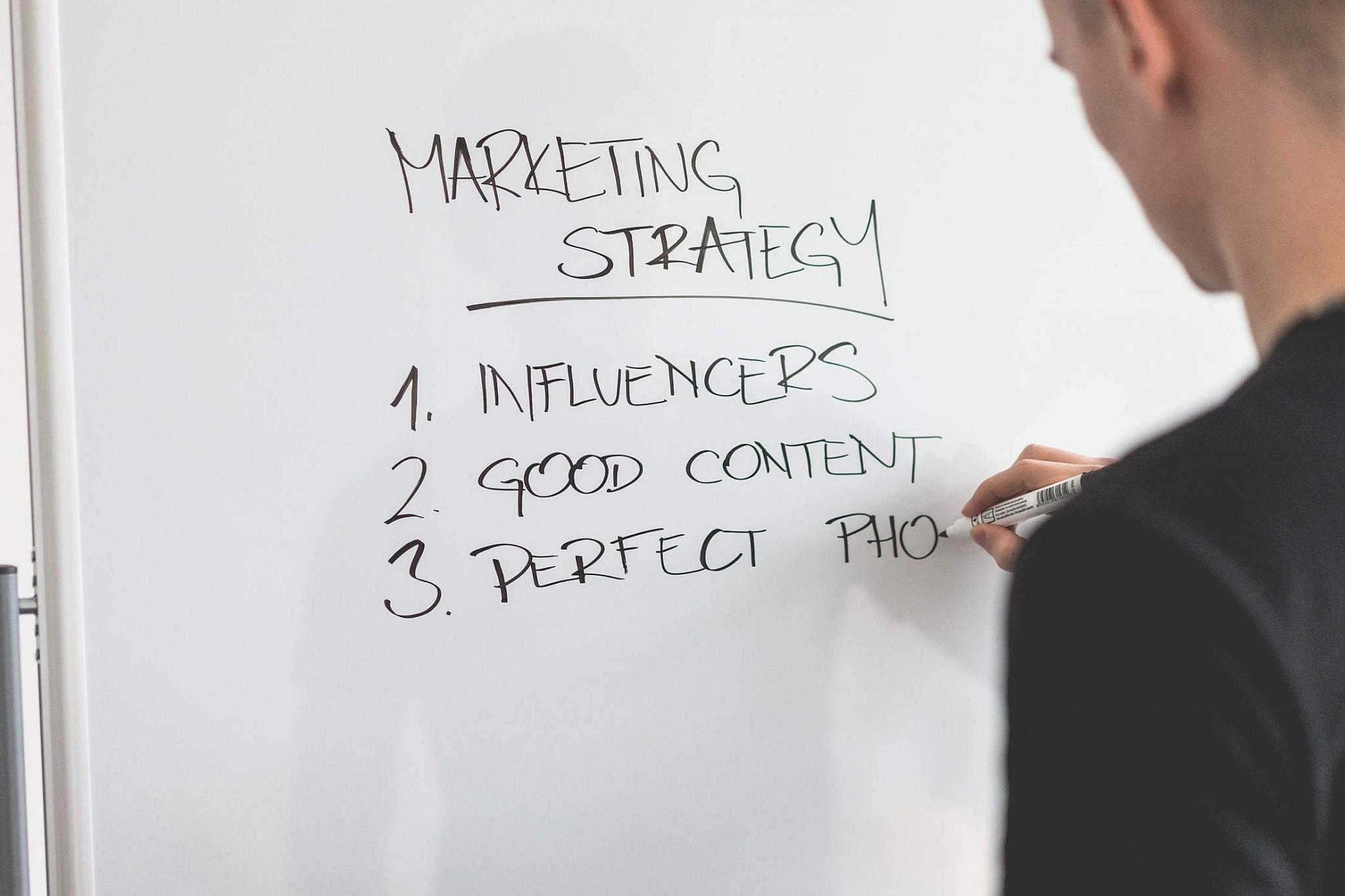 marketing-expert-writing-new-marketing-strategy-on-whiteboard_free_stock_photos_picjumbo_DSC03811-2210x1474