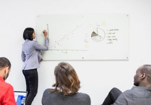 girl-presents-on-whiteboard_925x