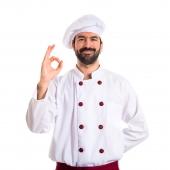 Chef making Ok sign over white background
