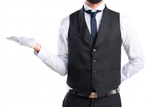Luxury waiter holding something